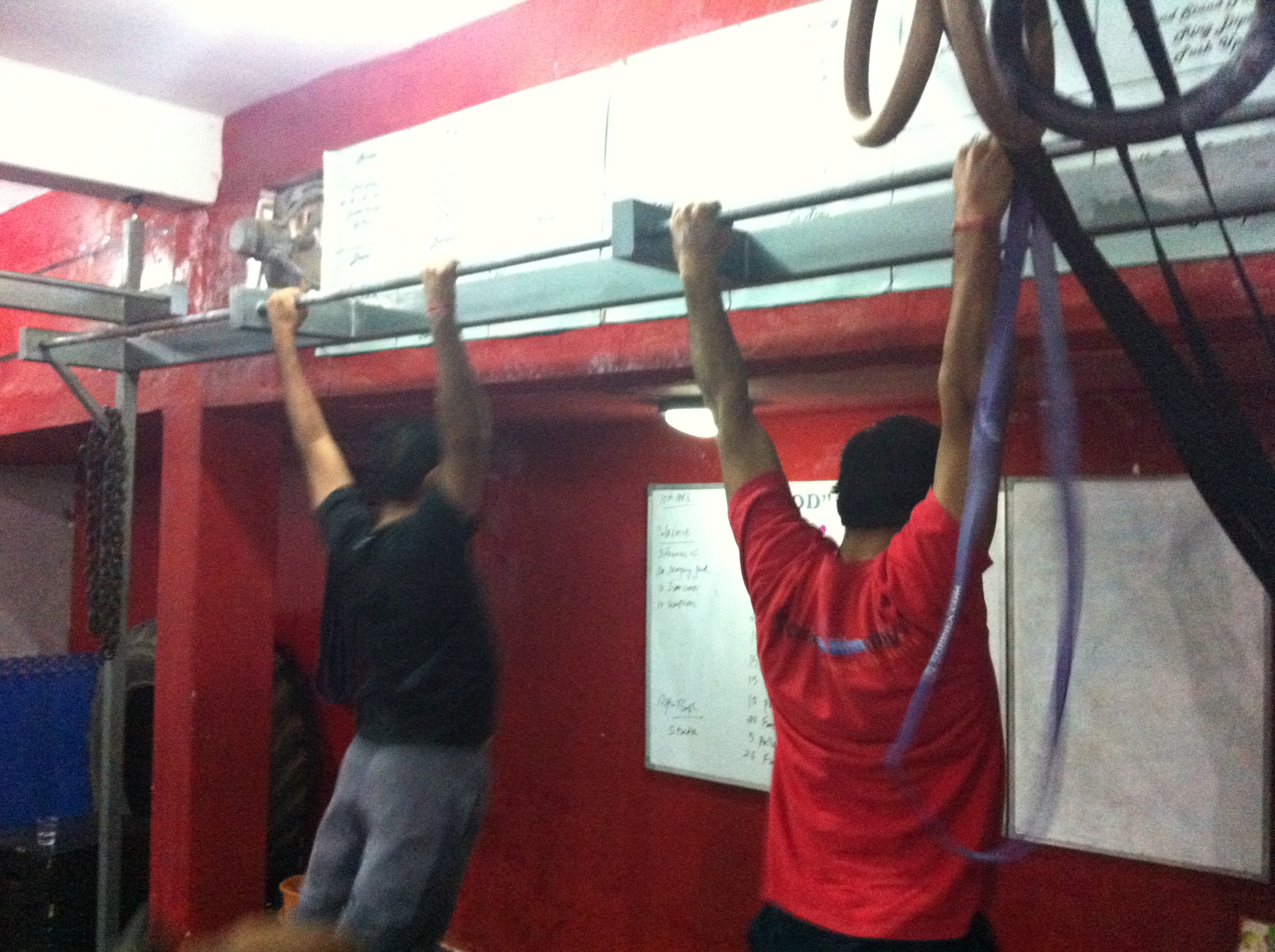 Pull ups are in the action.  Ayush and Coach Naveen