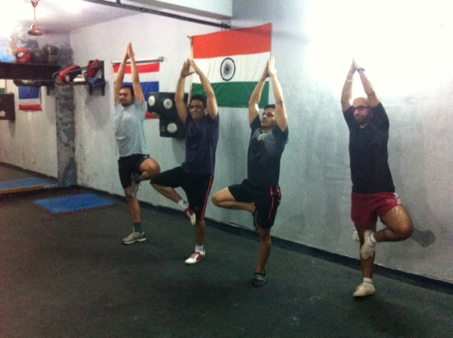 Himalayans trying their hands on yoga with coach Naveen - after bash