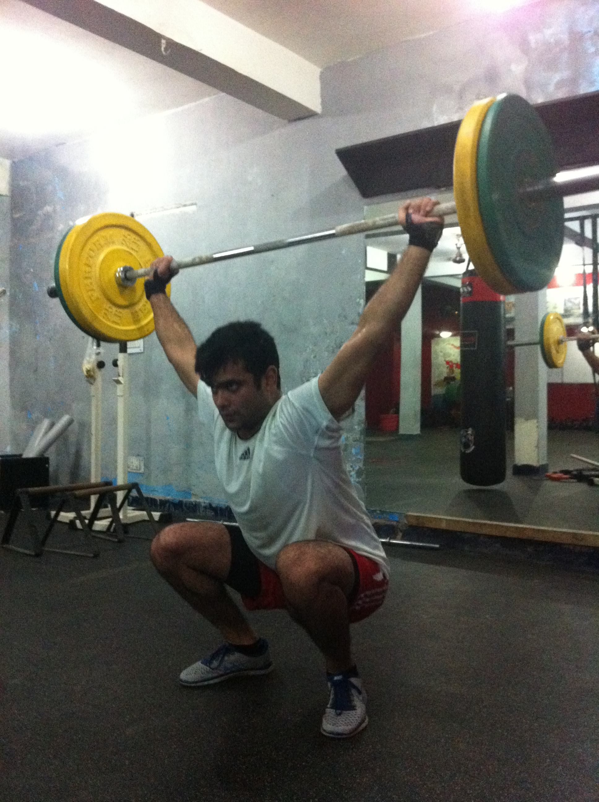 """Mr """"Z"""" performing ass to grass over head squats with some serious weight"""