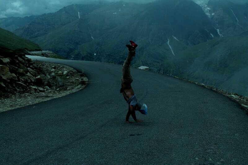Handstand walk at Rohtang pass.   13,000 ft