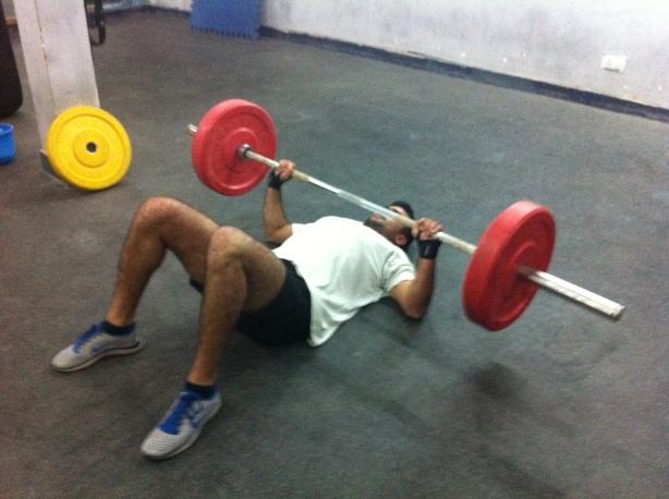 Z doing floor bench press